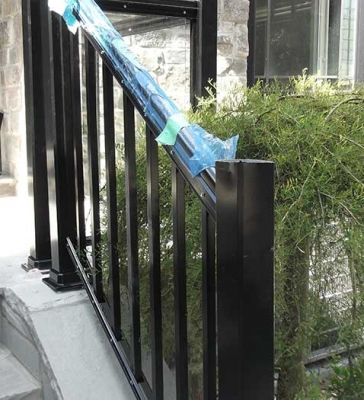 Aluminum-Glass-Railing-During-Installation Process-inf ront-of-a-house-in-New-Market