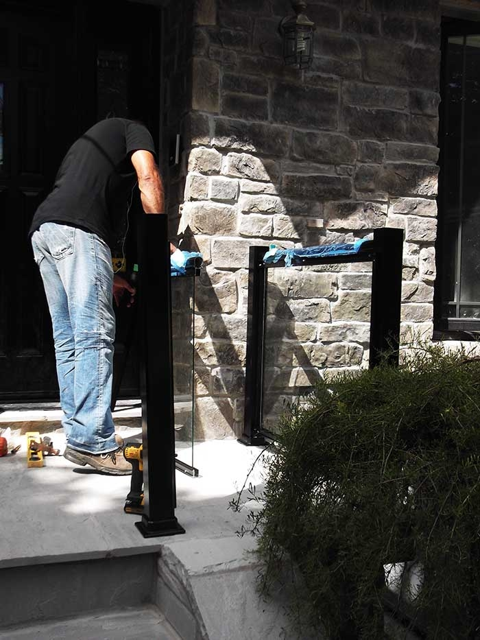 Aluminum-Glass-Railing-During-InstallationProcess-infront-of-the-house-in-New-Market-Ontario by aluminumwindowstoronto.ca