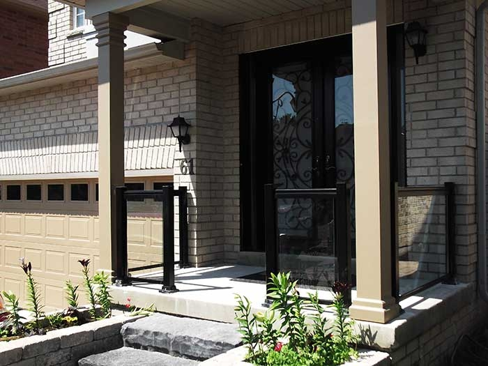 Aluminum-Railing-with-Glass-&-Milan-Design-Doyble-Fiberglass-Doors-with-multi-Point-Locks-and-2-Slim-Side-Lights-installed-in-Richmondhill by aluminumwindowstoronto.ca
